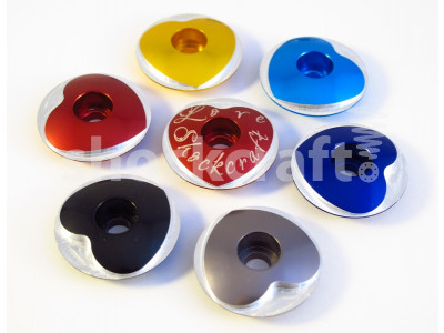 Heart Stem Caps in (clockwise from left) red, gold, bright blue, deep blue, pewter or black